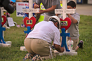 Greg Aznis, a Carpenter from Aurora Illinois dropped off three crosses for the killed police officers in Baton Rouge in front of the  B-Quik gas station that continues to grow. <br /> Zanis is known for placing crosses at the scenes of tragedies across America. He installed  <br />  49  crosses in Orlando, Florida  and just came from Michigan where he dropped off two for the killed court officers. Next stop for Aznis is Dallas where six crosses for those killed officers remain in the back of his pick-up truck.