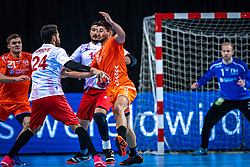 The Dutch handball player Robin Schoenaker in action during the European Championship qualifying match against Turkey in the Topsport Center Almere.