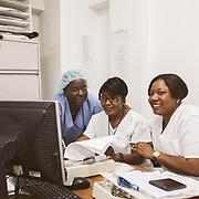 INDIVIDUAL(S) PHOTOGRAPHED: From left to right: Youstine Mondesir, Rosemarie Georges, and Magali Célestin. LOCATION: Sacré-Cœur Hospital, Milot Commune, Cap-Haïtien, Haïti. CAPTION: Nurses Youstine Mondesir, Rosemarie Georges, and Magali Célestin work in the Orthopedic Department of Sacré-Coeur Hospital.