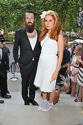 Artist RICHIE CULVER and PALOMA FAITH at the launch of Hideaways House at Morton's Club, Berkeley Square, London on 25th July 2012.
