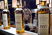 Moscow, Russia, 28/09/2005..The first Millionaire Fair in Moscow at the Crocus City Expo Centre attracted thousands of would-be and existing Russian millionaires to view and purchase a wide range of luxury goods. Macallan single malt whiskies on sale at up to $50,000 a bottle..