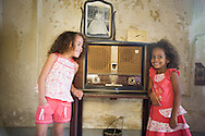 CUBA: Havana. children's fashion, little girls in a old decaying house      / Cuba. La Havane.  mode enfant . petites filles dans une maison bourgeoise délabrée    D1FCuba,