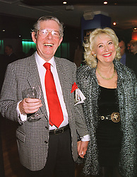 MR & MRS DEREK JAMESON, he is the former newspaper editor, at a party in London on 8th April 1999.MPW 16