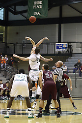 15 December 2012:  Kevin Reed tips off with Matt MacKenzie during an NCAA mens division 3 basketball game between theUniversity of Chicago Maroons and the Illinois Wesleyan Titans in Shirk Center, Bloomington IL