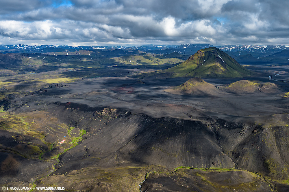 The tiny huts of Emstrur can be seen in the canion below Hattafell mountain.
