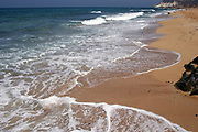 Summer vacation concept image wavelets on a sandy beach