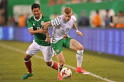 June 1, 2017 - East Rutherford, New Jersey, U.S - Mexico forward CARLOS VELA (11) and Republic of Ireland midfielder JAMES MCCLEAN (11) in action during an international friendly match at Met Life Stadium in East Rutherford New Jersey Mexico defeats Republic of Ireland 3 to 1 (Credit Image: © Brooks Von Arx via ZUMA Wire)