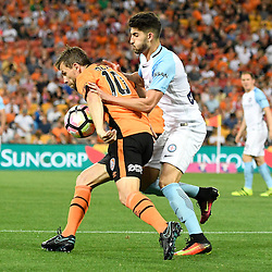 BRISBANE, AUSTRALIA - OCTOBER 30: Paulo Retre of Melbourne and Brett Holman of the Roar compete for the ball during the round 5 Hyundai A-League match between the Brisbane Roar and Melbourne City at Suncorp Stadium on November 4, 2016 in Brisbane, Australia. (Photo by Patrick Kearney/Brisbane Roar)