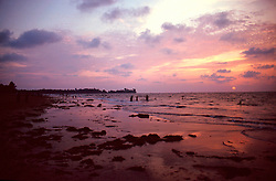 BURMA CHAUNG THA/BAY OF BENGAL MAR95 - Sun sets on a beach at the Bay of Bengal. Chaung Tha is a small but popular destination for Burmese urban dwellers to come and relax. .  jre/Photo by Jiri Rezac. . © Jiri Rezac 1995. . Contact: +44 (0) 7050 110 417. Mobile: +44 (0) 7801 337 683. Office: +44 (0) 20 8968 9635. . Email: jiri@jirirezac.com. Web: www.jirirezac.com