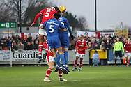 AFC Wimbledon defender Will Nightingale (5) and AFC Wimbledon striker Joe Pigott (39) battles for possession with Barnsley defender Ethan Pinnock (5) during the EFL Sky Bet League 1 match between AFC Wimbledon and Barnsley at the Cherry Red Records Stadium, Kingston, England on 19 January 2019.