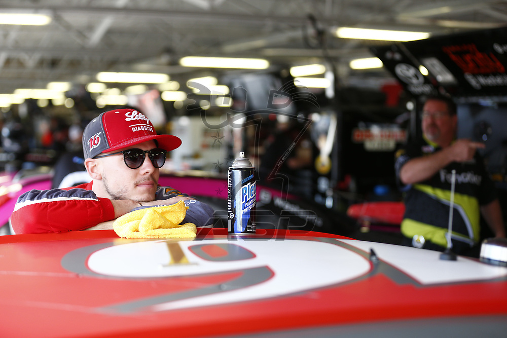October 20, 2017 - Kansas City, Kansas, USA: \{persons}n\ hangs out in the garage during practice for the Kansas Lottery 300 at Kansas Speedway in Kansas City, Kansas.