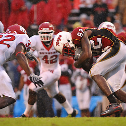 Sep 26, 2009; College Park, MD, USA; Maryland wide receiver Torrey Smith (82) lowers his head before contact with Rutgers cornerback Duron Harmon (32) during Rutgers' 34-13 victory over Maryland in NCAA college football at Byrd Stadium.