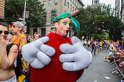 A marcher wearing what appears to be a tomato costume on Christopher Street.