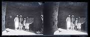 stereo glass plate with family posing in a grotto entrance France 1900s