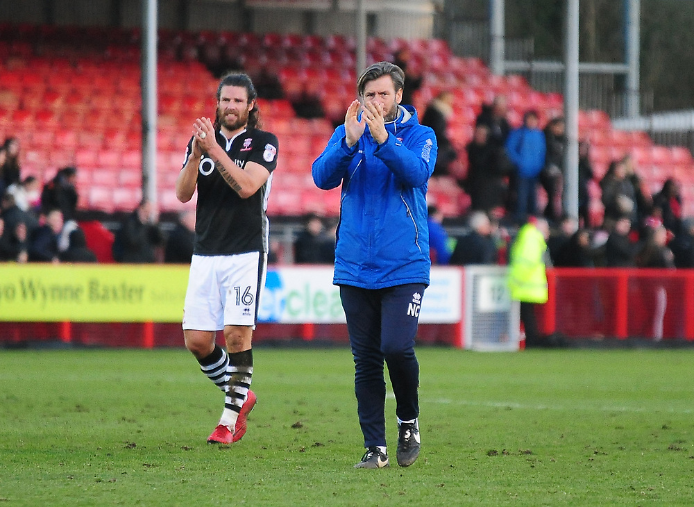 Lincoln City's assistant manager Nicky Cowley and Michael Bostwick applauds the fans at the final whistle<br /> <br /> Photographer Andrew Vaughan/CameraSport<br /> <br /> The EFL Sky Bet League Two - Crawley Town v Lincoln City - Saturday 17th February 2018 - Broadfield Stadium - Crawley<br /> <br /> World Copyright © 2018 CameraSport. All rights reserved. 43 Linden Ave. Countesthorpe. Leicester. England. LE8 5PG - Tel: +44 (0) 116 277 4147 - admin@camerasport.com - www.camerasport.com