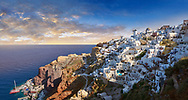 Sunset over Oia (ia), Cyclades Island of  Thira, Santorini, Greece.<br /> <br /> The settlement of Oia had been mentioned in various travel reports before the beginning of Venetian rule, when Marco Sanudo founded the Duchy of Naxos in 1207 and feudal rule was instituted on Santorini. n 1537, Hayreddin Barbarossa conquered the Aegean islands and placed them under Sultan Selim II. However, Santorini remained under the Crispo family until 1566, passing then to Joseph Nasi and after his death in 1579 to the Ottoman Empire. .<br /> <br /> If you prefer to buy from our ALAMY PHOTO LIBRARY  Collection visit : https://www.alamy.com/portfolio/paul-williams-funkystock/santorini-greece.html<br /> <br /> Visit our PHOTO COLLECTIONS OF GREECE for more photos to download or buy as wall art prints https://funkystock.photoshelter.com/gallery-collection/Pictures-Images-of-Greece-Photos-of-Greek-Historic-Landmark-Sites/C0000w6e8OkknEb8