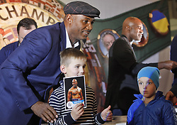 October 2, 2018 - Kiev, Ukraine - Former Boxing Champion LENNOX LEWIS (L) and former Boxing Champion EVANDER HOLYFIELD (R) attend an authographs session for supporters at the 56th World Boxing Convention in Kiev, Ukraine, on 2 October 2018.The WBC 56th congress in which take part boxing legends Evander Holyfield,Lennox Lewis, Eric Morales and about 700 participants from 160 countries runs in Kiev from from September 30 to October 5. (Credit Image: © Serg Glovny/ZUMA Wire)