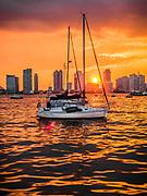 The sunset is in Midtown Manhattan Harbor, New York City.