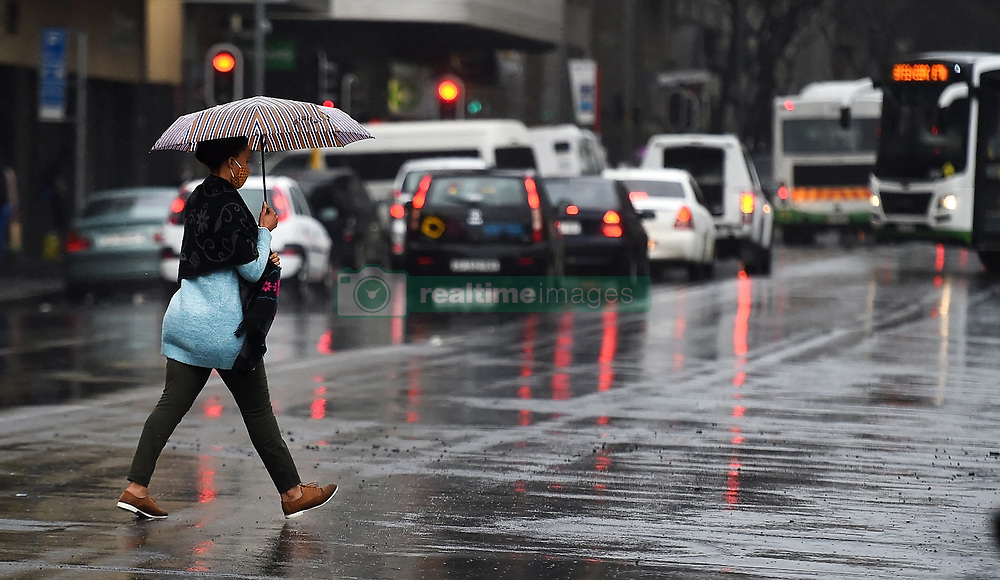 South Africa -Cape Town - 31 August 2020 - A lady crossing darling street  during a heavy rain in Cape Town.The cold and wet weather is expected to continue for the rest of the week in Cape Town  .Picture:Phando Jikelo/African News Agency(ANA)