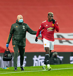 MANCHESTER, ENGLAND - Friday, January 1, 2020: Manchester United's Paul Pogba is treated for an injury during the New Year's Day FA Premier League match between Manchester United FC and Aston Villa FC at Old Trafford. The game was played behind closed doors due to the UK government putting Greater Manchester in Tier 4: Stay at Home during the Coronavirus COVID-19 Pandemic. (Pic by David Rawcliffe/Propaganda)