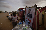 """Advertising campaign flags from Popular Movement for the Liberation of Angola (MPLA) with the figure of José Eduardo dos Santos, are scattered trough the """"musseques"""" around  the capital, Luanda, on the 27 August 2012. Elections will take place on August 31."""