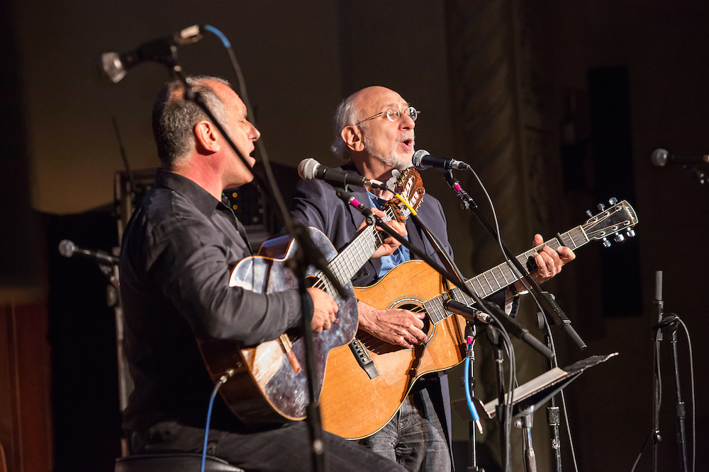 Peter Yarrow, on the right, and David Broza, perform together at the Folk City benefit concert. Yarrow is best known as a founder of the group Peter, Paul and Mary, and Broza is an Israeli singer-songwriter.