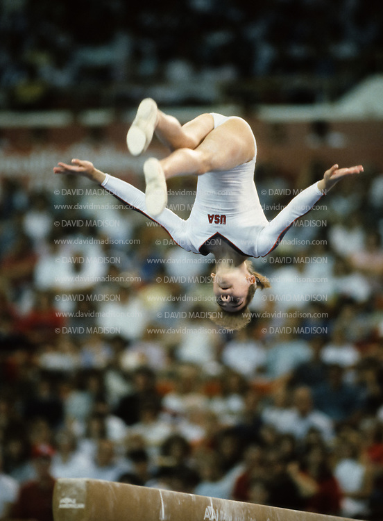 PHOENIX - APRIL 24:  Chelle Stack of the United States performs in the balance beam event during a USA - USSR gymnastics meet on April 24, 1988  at the Arizona Veterans Memorial Coliseum in Phoenix, Arizona.  (Photo by David Madison/Getty Images)