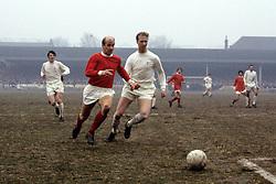 (L-R) Manchester United's Bobby Charlton takes on Leeds United's Jack Charlton