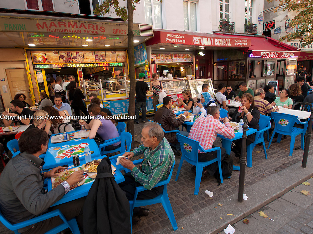 Typical busy ethnic pavement restaurant in the Marais district of Paris France