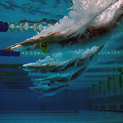 An underwater view as swimmers enter the water at the start of the men's 50m freestyle heats during the Australian Swimming Championships and Selection Trials for the XIII Fina World Championships held at Sydney Olympic Park Aquatic Centre, Sydney, Australia on March 21, 2009. Photo Tim Clayton