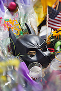 SHOT 7/23/12 4:12:16 PM - A Batman mask was one of the items left as community members pay their respects to the victims of the movie theater shootings at a makeshift memorial near the Century 16 Movie Theaters at the Aurora Town Center in Aurora, Colo. Twelve crosses have been placed at the memorial by Greg Zanis, from Aurora, Ill., the same man behind the crosses dedicated after the Columbine shootings thirteen years ago. James Eagan Holmes will face charges in the shootings that occurred on Friday July 20, 2012 in which twelve people were killed and another 58 were injured. (Photo by Marc Piscotty / © 2012)