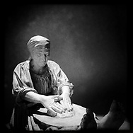 """The bread"". Plaster sculpture by Italian sculptor Francesco Ciusa exhibited at Tribu museum in Nuoro (Sardinia), Italy. 2014."