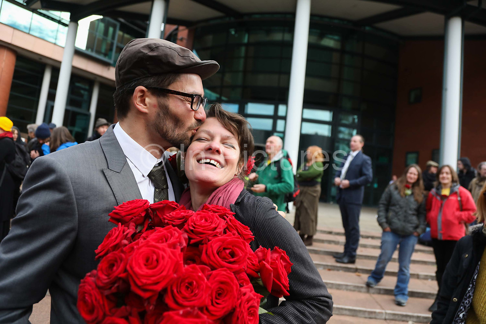 "Outside Preston Crown Court, Roscoe kisses his partner before heading into cour,  September 25th, Preston, Lancashire, United Kingdom. Simon Roscoe Blevins, 26,  Richard Roberts, 36 were both sentenced 16 months in prison, Richard Loizou, 31, sentenced 15 months in prison and  and Julian Brock, 47 12 months supended. Simon Roscoe Blevins, 26,  Richard Loizou, 31, Richard Roberts, 36 and Julian Brock, 47 climbed on top of several trucks during a mass protest by locals and supporters in New Preston Road, against fracking in Lancashire, July 2017. The trucks were prevented form delivering equipment to Cuadrillas nearby fracking site for four days. After a seven day jury trial at Preston Crown Court in August 2018, the four men were found guilty of Public Nuisance. Judge Altham has told them to expect ""immediate custodial sentences"" on 25th September 2018."