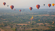 View of Bagan and hot air balloons over the Bagan plain. It is an ancient city and a UNESCO World Heritage Site in the Mandalay Region of Myanmar. In the Bagan plains alone the remains of over 2200 temples and pagodas survive.