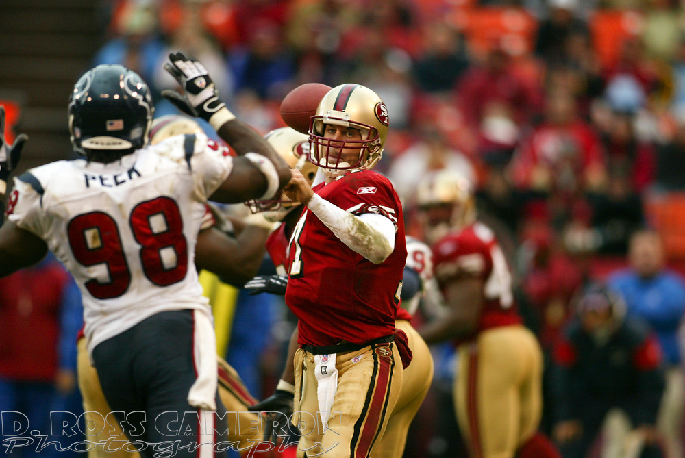 San Francisco 49ers quarterback Alex Smith (11) looks for an open man during the third quarter of an NFL football game against the Houston Texans, Sunday, Jan. 1, 2006 at Candlestick Park in San Francisco.  The 49ers won in overtime, 20-17. (D. Ross Cameron/The Oakland Tribune)