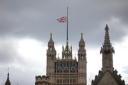 © Licensed to London News Pictures. 09/04/2021. London, UK. Flags above the Houses of Parliament fly at half mast. The Duke of Edinburgh Prince Philip, Queen Elizabeth II's husband, has died aged 99 Buckingham Palace has announced. Photo credit: Rob Pinney/LNP