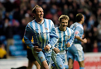 Photo: Leigh Quinnell.<br /> Coventry City v Plymouth Argyle. Coca Cola Championship.<br /> 03/12/2005. Coventrys Andy Morrell celebrates his goal by sticking the ball up his shirt.