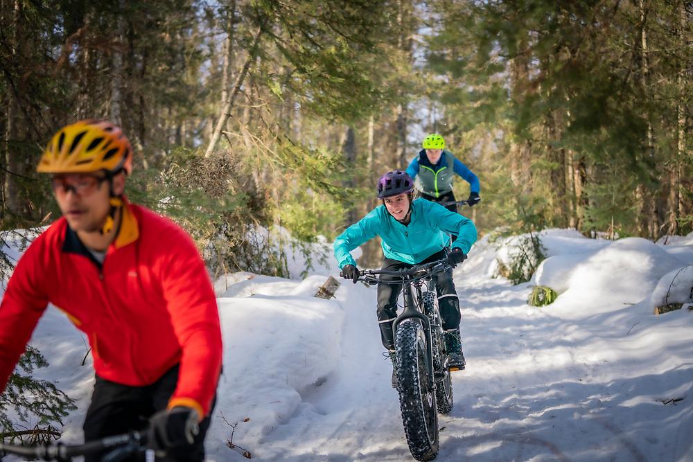 Friends fat biking in winter in Ishpeming and Marquette, Michigan.