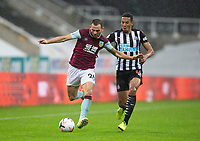 Football - 2021 / 2021 Premier League - Newcastle United vs Burnley - St Jame's Park<br /> <br /> Phil Bardsley of Burnley FC vies with Isaac Hayden of Newcastle United<br /> <br /> COLORSPORT/BRUCE WHITE
