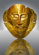 """Gold Death Mask Known as the """"mask of Agamemnon""""  from Grave V, Grave Circle A, Mycenae. The mask is made of a thin sheet of beaten gold & shows a man with a beard. 16th century BC. Cat No 624 Athens Archaeological Museum. .<br /> <br /> If you prefer to buy from our ALAMY PHOTO LIBRARY  Collection visit : https://www.alamy.com/portfolio/paul-williams-funkystock/mycenaean-art-artefacts.html . Type -   Athens    - into the LOWER SEARCH WITHIN GALLERY box. Refine search by adding background colour, place, museum etc<br /> <br /> Visit our MYCENAEN ART PHOTO COLLECTIONS for more photos to download  as wall art prints https://funkystock.photoshelter.com/gallery-collection/Pictures-Images-of-Ancient-Mycenaean-Art-Artefacts-Archaeology-Sites/C0000xRC5WLQcbhQ"""