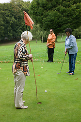 Group of older women playing pitch and putt,