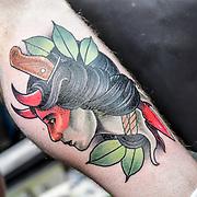 Matt Edwards TattooER, Tattoo a client at The Great British Tattoo Show, on 26 May 2019, London, UK.