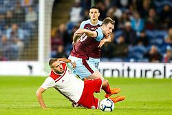 Ashley Barnes of Burnley takes on Kostas Fortounis of Olympiakos - Mandatory by-line: Robbie Stephenson/JMP - 30/08/2018 - FOOTBALL - Turf Moor - Burnley, England - Burnley v Olympiakos - UEFA Europa League Play-offs second leg