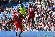 Gaetan Bong wins a header against Gael Kakuta during the Pre-Season Friendly match between Brighton and Hove Albion and Sevilla at the American Express Community Stadium, Brighton and Hove, England on 2 August 2015. Photo by Bennett Dean.