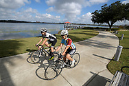 Jennifer, right, and Darrell Cunningham bicycle together as a couple around Lake Baldwin, Monday, Dec. 12, 2016, in Orlando, Fla. (Phelan M. Ebenhack via AP)