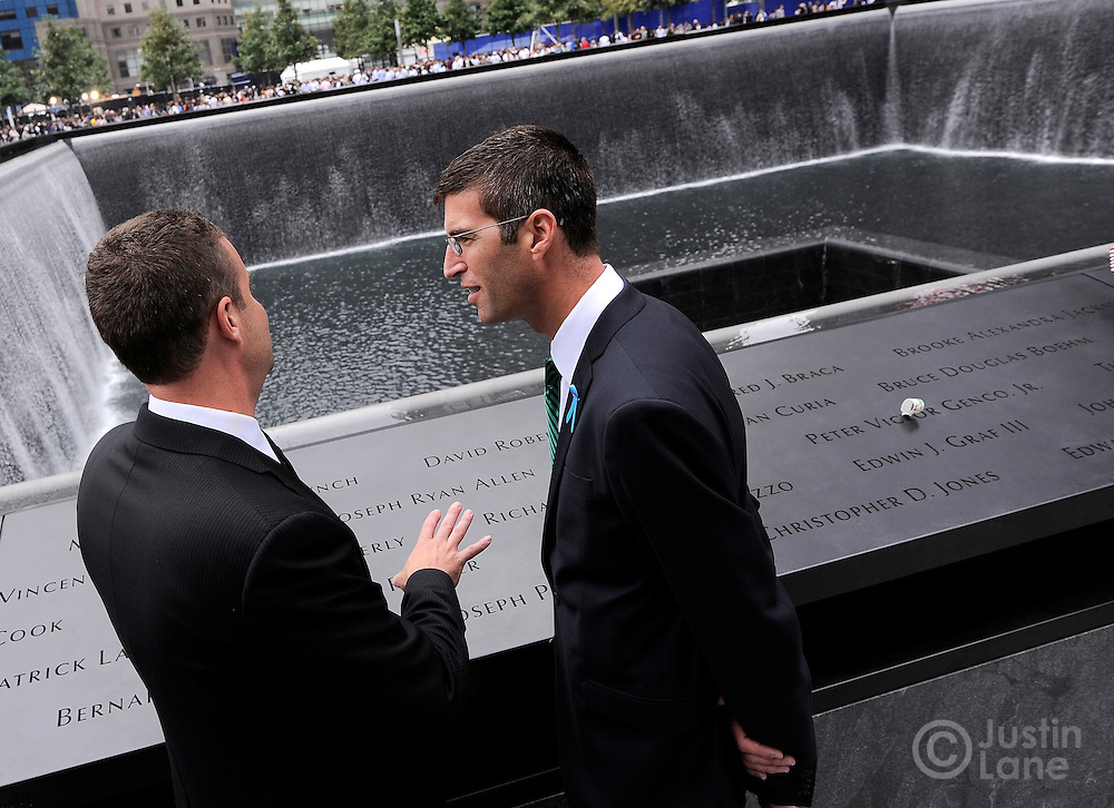 Architect Michael Arad (R), who designed the 9/11 Memorial, is seen next to the North Pool of the 9/11 Memorial during tenth anniversary ceremonies at the site of the World Trade Center September 11, 2011, in New York. POOL/Justin Lane/EPA