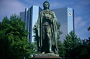 The statue of Johann Christoph Friedrich von Schiller (1759 - 1805) the German poet, philosopher, historian, and playwright in Frankfurt's financial district - its skyscrapers from a new era rising behind. In Friedrich von Schillers honor the city of Frankfurt errected this Memorial on May 9, 1864 at the Hauptwache. The bronze is styled by Johannes Dielmann at the cost of 14,070 Gulden and 17 Kreuzer. 1938 the bronze was moved to the Rathenauplatz. Since 1955 it is situated here at the Taunusanlage.