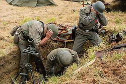 Reenactors portraying a Mortar team from the Panzer Grenadier Division Großdeutschland firing an 8 cm Granatwerfer 34 (8 cm GrW 34) which was the standard German infantry mortar throughout World War II