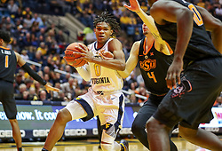 Jan 12, 2019; Morgantown, WV, USA; West Virginia Mountaineers guard Trey Doomes (0) drives and shoots during the second half against the Oklahoma State Cowboys at WVU Coliseum. Mandatory Credit: Ben Queen-USA TODAY Sports