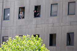 An Iranian policeman holds a weapon as he stands by a window at the Iranian parliament in the capital Tehran on June 7, 2017 during an attack on the complex. The Islamic State group claimed its first attacks in Iran as gunmen and suicide bombers killed at least five people in twin assaults on parliament and the tomb of the country's revolutionary founder in Tehran. Photo by Vahabzadeh FarsNews/ParsPix/ABACAPRESS.COM